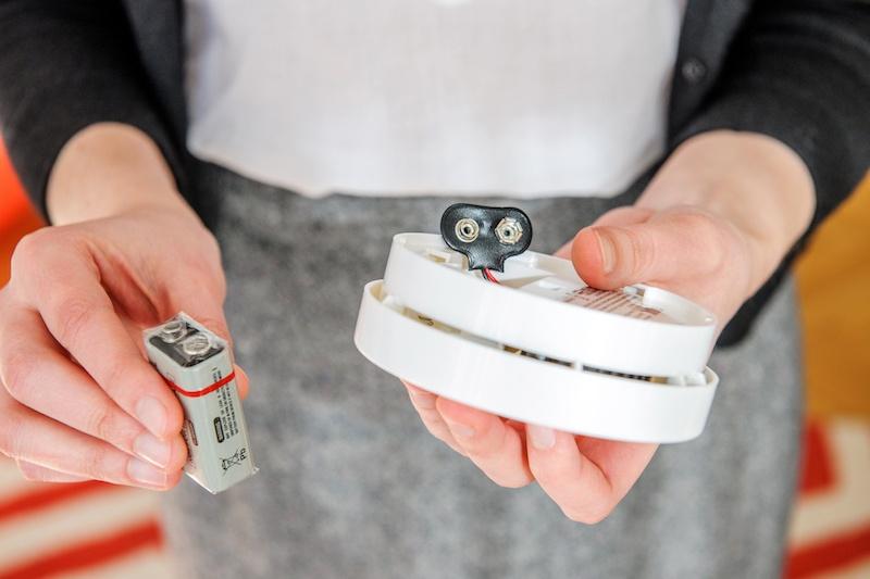 replacing battery in smoke detector.jpg